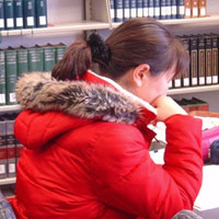 woman using the library at Biblical Theological Seminary [photo]