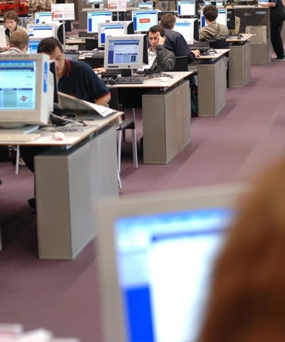 Library with many people using computers