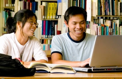 Asian students using a laptop computer