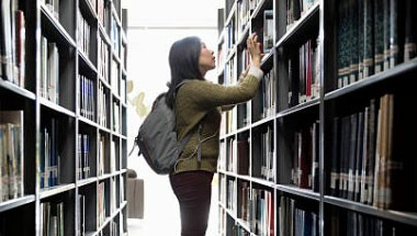 Library user browsing shelves