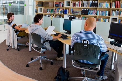Students using computers in library