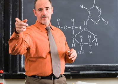 Male professor in front of chalkboard
