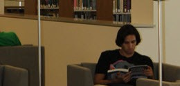 Student reading in Saddleback College Library