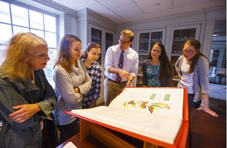 Keith explaining the Saint John's Bible facsimile on loan to Saint Anselm College