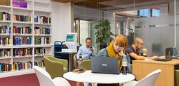 Students in a UCL library space