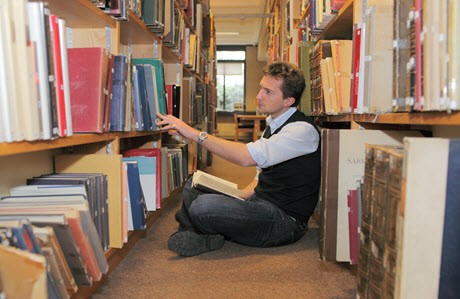 Photo of professor working in The University of Warwick library