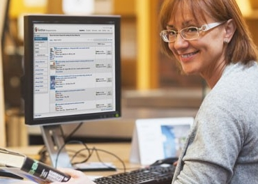 Female librarian using WorldShare Acquisitions on computer