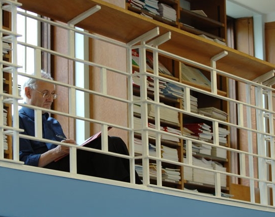 Man reading in library
