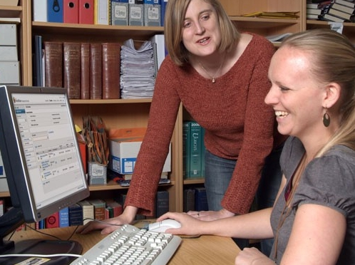 Female library workers using WorldShare Circulation