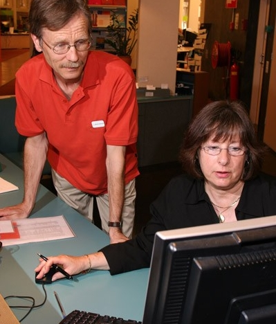 Librarians using a computer
