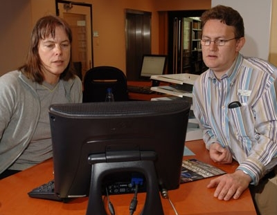 Two librarians using computer