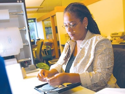 Woman cataloging a DVD
