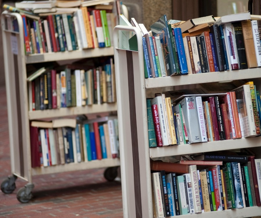 Books on cart in library