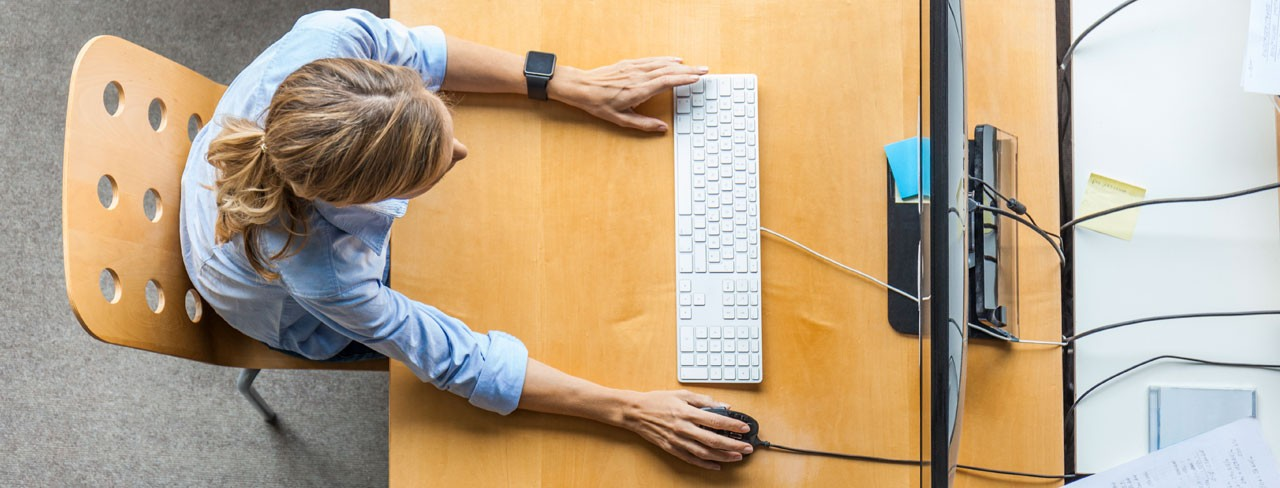 Woman using computer on a desk