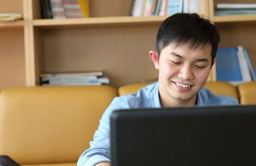 Asian man using laptop computer
