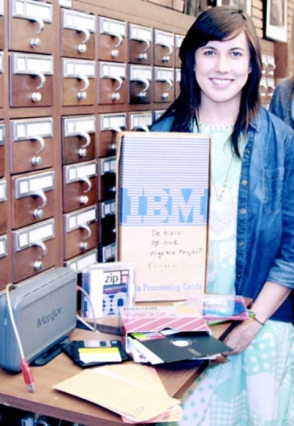 Photo of archivist Gloria Gonzalez with digital archive materials